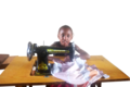 A young girl learning tailoring skills.png