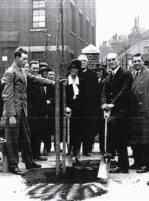 Ada Salter - Ada opens a playground by planting a tree. Alfred is on her left.