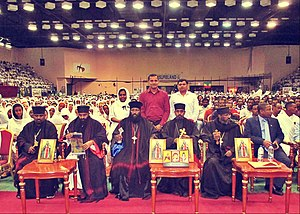 Prelates seated before a large audience