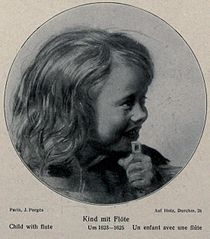 Laughing child with a flute
