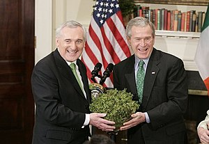 Bertie Ahern - President George W. Bush accepts a bowl of shamrock from Taoiseach Bertie Ahern during a ceremony celebrating St. Patrick's Day in 2005.