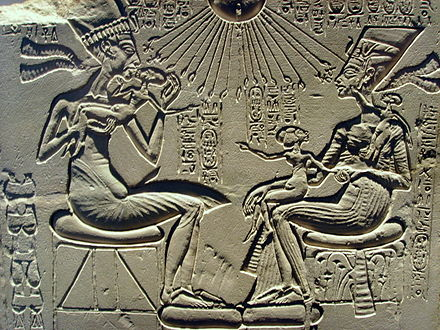A sunk-relief depiction of Pharaoh Akhenaten with his wife Nefertiti and daughters. The main background has not been removed, merely that in the immediate vicinity of the sculpted form. Note how strong shadows are needed to define the image. Akhenaten, Nefertiti and their children.jpg