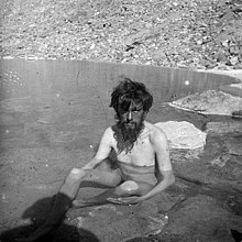 Crowley bathing in a spring during the K2 Expedition