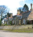 Almshouses by Stow Bardolph Hall - geograph.org.uk - 1737283.jpg
