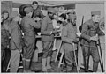 American soldiers getting their bowls of chocolate and rolls in the American Red Cross canteen at Toulouse France.jpg