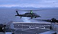 An Alaska Air National Guard HH-60 Pave Hawk helicopter, assigned to the 210th Rescue Squadron, prepares to land on the flight deck of the amphibious transport dock ship USS Anchorage (LPD 23) in the Cook Inlet 130430-F-NZ143-854.jpg