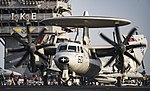 An E-2C Hawkeye taxis across the flight deck of USS Dwight D. Eisenhower. (28789073682).jpg