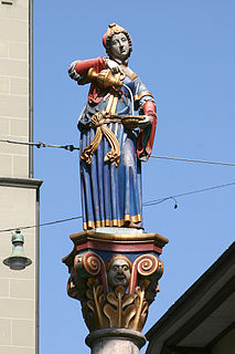 figure fountain with a side fountain from the 16th century in the Marktgasse of the city of Bern, Switzerland