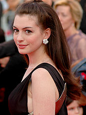 A picture of Anne Hathaway looking to her left into the camera.
