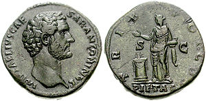Pietas - Pietas, as a virtue of the emperor Antoninus Pius, represented by a woman offering a sacrifice on the reverse of this sestertius