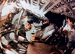 In-flight footage of the crew taken while they were in orbit around the Moon; Frank Borman is in the center.