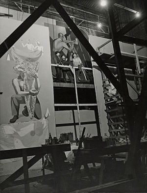 Anton Refregier - Refregier on scaffold at work on mural at WPA Building of the 1939 N.Y. World's Fair. Photographed for the Works Progress Administration.