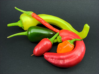 Capsicum - An arrangement of chilis, including jalapeno, banana, cayenne, and habanero peppers.