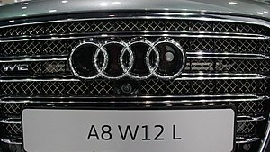 Automotive night vision - Night Vision Assistant infrared camera visible on Audi A8 grill, right circle