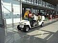 BJ 北京首都國際機場 Beijing Capital International Airport BCIA Terminal 3 interior electric golf car driver Aug-2010.JPG