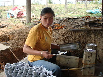 Xiangkhouang Province - A spoon seller in Ban Napia