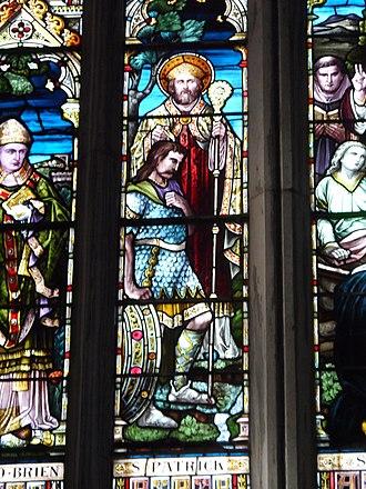 Óengus mac Nad Froích - Baptism of Óengus by Saint Patrick, stained glass, St Ailbe's Church, Emly.