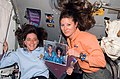 Barbara Morgan & Tracy Caldwell STS-118 on ISS with photo tributes (S118-E-09265).jpg