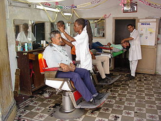 Santiago de Cuba - Family-owned barbershops are a hallmark of Santiago
