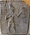 Basalt wall slab, relief, from Sam'al, Turkey, 10th-8th century BCE. Relief of a warrior with a spear, sword, and shield. Pergamon Museum, Berlin, Germany.jpg
