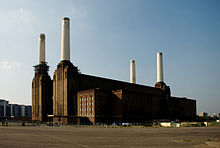Photo of a large building with four tall chimneys.