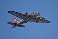 Boeing B-17G-85-DL Flying Fortress Nine-O-Nine Arrival Pass 04 CFatKAM 09Feb2011 (14983577722).jpg
