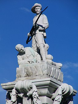 "The top of the Dunedin Boer War Memorial. The memorial reaffirms New Zealand's dedication to the Empire. As McLean and Phillips said, the New Zealand Boer War Memorials are ""tributes to the Empire and outpourings of pride about New Zealand's place"" in the Empire. Boer War Memorial, Dunedin, NZ soldiers.JPG"