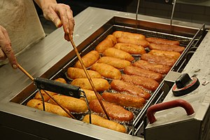 Deep frying - Czech bramboráček bread being deep fried