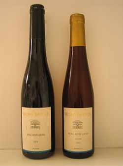 4382a1349 A bottle of regular Riesling Auslese (left) and a bottle of Riesling  Auslese Goldkapsel (Gold capsule) from the same producer.