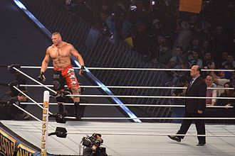 "Manager (professional wrestling) - Brock Lesnar being accompanied by his ""Advocate"", Paul Heyman"