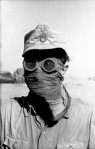 90th Light Infantry Division (Wehrmacht) - German infantryman seeking protection from desert dust: Western Desert: 1942.