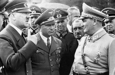 (from left) Hitler; Robert Ley, head of the German Labour Front; Ferdinand Porsche, armaments manufacturer; and Hermann Goring, head of the Four Year Plan (1942) Bundesarchiv Bild 101III-Reprich-012-08, Wolfschanze, Hitler, Ley, Porsche und Goring.jpg