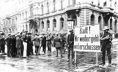 "Putschists in Berlin. The banner warns: ""Stop! Whoever proceeds will be shot"". Bundesarchiv Bild 183-J0305-0600-003, Berlin, Kapp-Putsch, Putschisten.jpg"