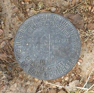 Cadastre - BLM cadastral survey marker from 1992 in San Xavier, Arizona