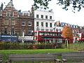 Buses by Islington Green, London.JPG