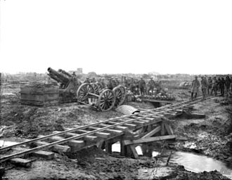 2 ft and 600 mm gauge railways - A BL 9.2-inch howitzer with shells lined up on the ground recently delivered from the trench railway in the foreground during World War I.