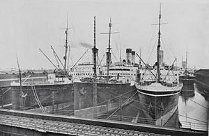 CP Ships - Three steamships docked together: ''Empress of France'', ''Empress of India'' and ''Empress of Britain''.