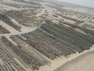 Camp Arifjan - Thousands of tires and other military equipment line a staging area, 2004.