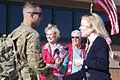 Carol Megathlin (right) shakes the hand of a returning Soldier at Hunter Army Airfield in Savannah, Ga., Nov. 24, 2012 121124-A-SA215-135.jpg