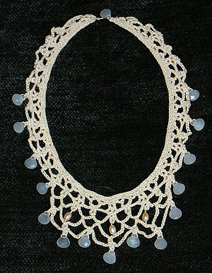 Bead crochet - A bead crochet necklace made from mercerized cotton, faceted chalcedony, and freshwater pearls.  Two different attachment methods were used: the chalcedony beads were strung before construction and moved into position during crocheting; the pearls were attached by means of silver pins afterward.  A chalcedony bead forms part of the clasp.