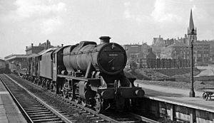 Chesterfield railway station - Freight through the station with the Crooked Spire in the background in 1961
