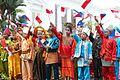 Children wave their flaglets during a welcome ceremony for President Rodrigo Duterte in Jakarta, Indonesia on September 9.jpg