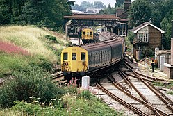Class 415 departs Mitcham Junction (1982).JPG