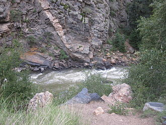 Clear Creek (Colorado) - A view of Clear Creek cutting through jagged rocks west of Golden
