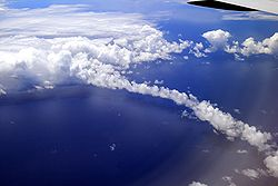 Clouds and cloud bow above Pacific