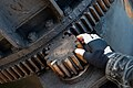 Cog wheel on a huge crane claw - size compaired to hand.jpg