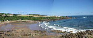 Surfing in Scotland - A panorama shot of Coldingham Sands from Homeli Knoll, the village of St Abbs is just visible over the headland.