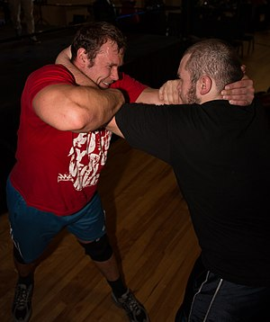 Collar-and-elbow position - Collar and elbow hold, as demonstrated by Maybach Beta (left, in red) and Holden Albright