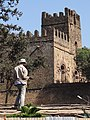 Construction Worker with Castle - Gondar - Ethiopia (8686275906).jpg