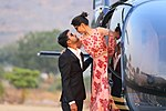 Couple with a helicopter, India.jpg